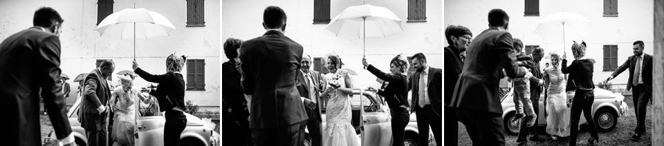 matrimonio con pioggia, sposa con ombrello bianco