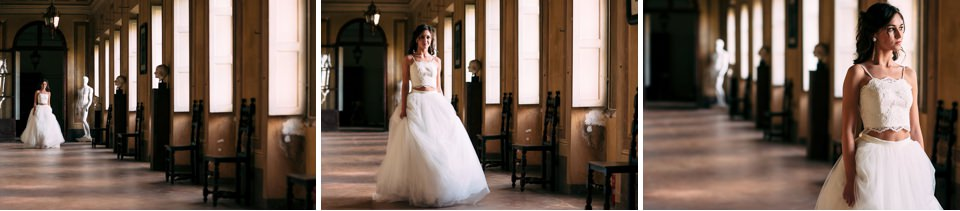 Elegant bride walks inside a prestigious villa with a long white dress