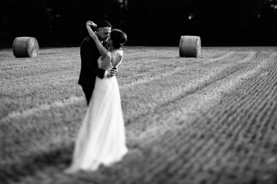 newlyweds in a field of wheat