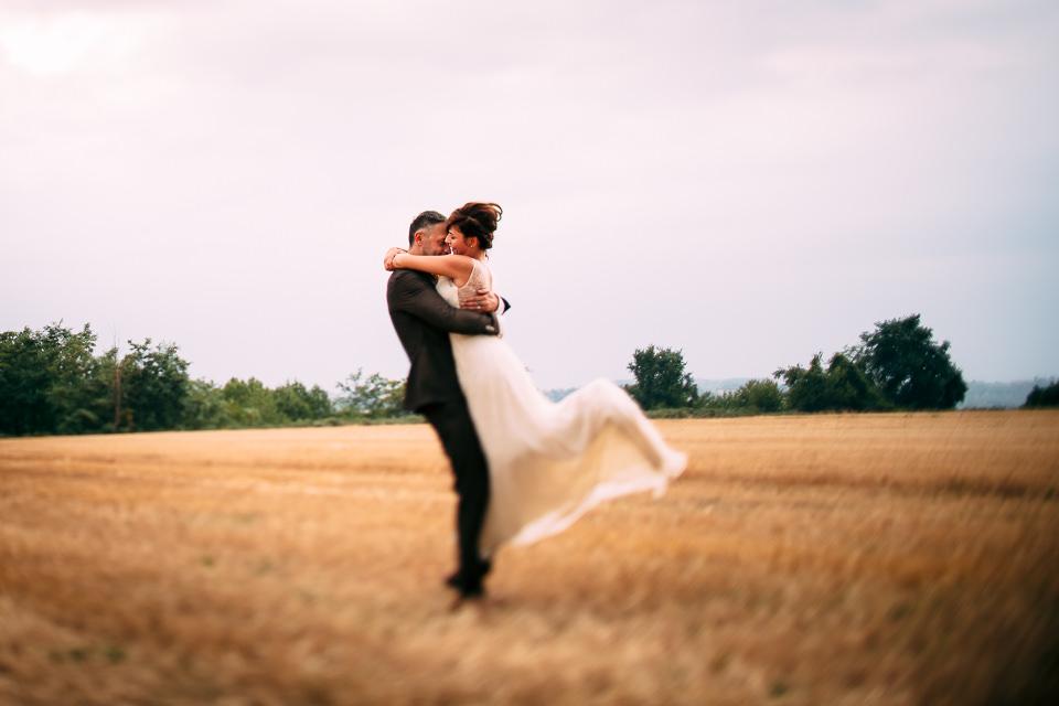 elegant bride hugging her husband