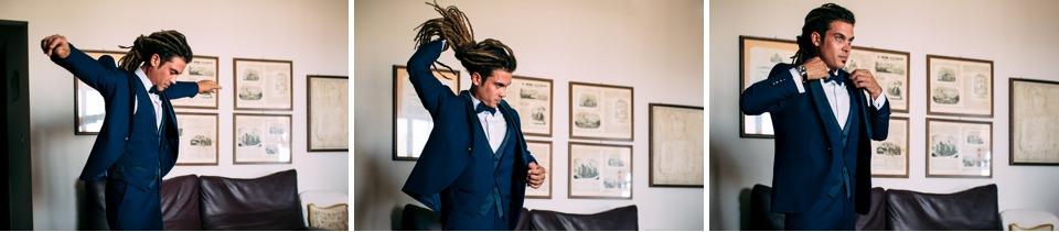 sposo con i dreadlocks in elegante abito blu