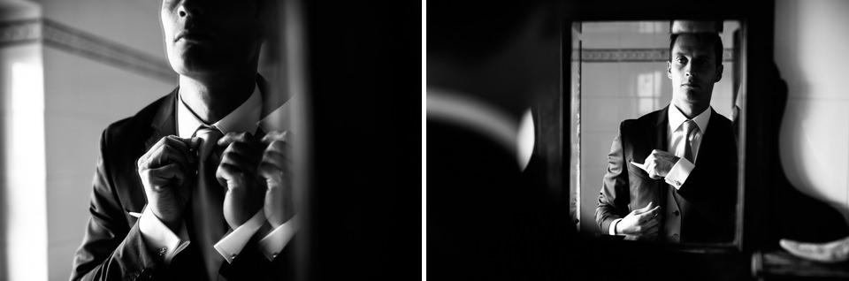 sposo si fa il nodo alla cravatta riflesso nello specchio